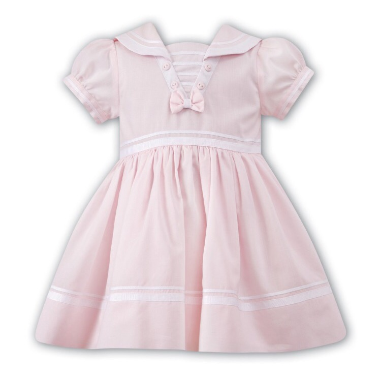 Dress your little one in these fun and whimsical girls' designer dresses that express her imagination. In ribbons and polka dots from Rare Editions, flared or flowing party dresses from Us Angels, or ruffles and flowers from Mimi & Maggie, she'll love the way she feels.